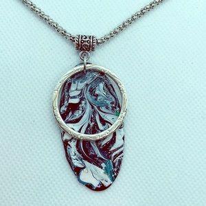 Jewelry - Blue acrylic skin pendant .